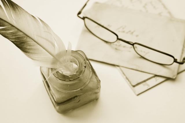 Quill pen and glasses