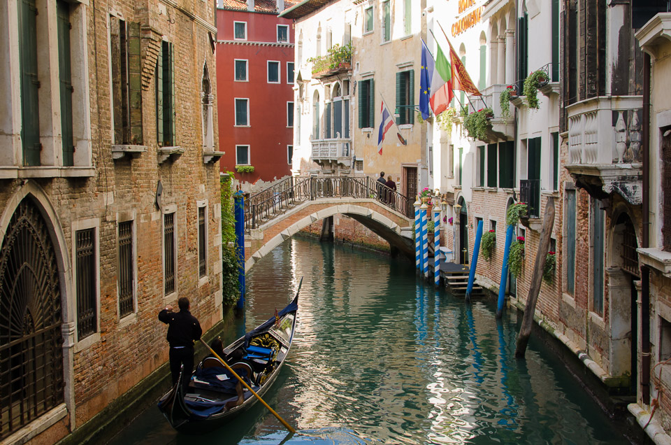 For literary travelers, a gondola glides through a small canal. © 2013 Charles & Mary Love
