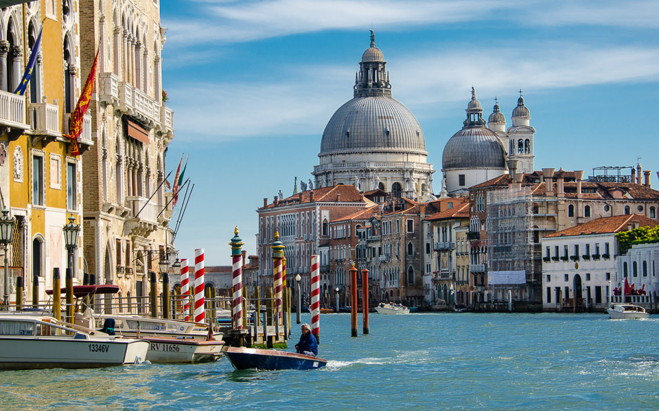 For literary travelers: a photograph of a small boat cruising the Grand Canal, Venice. © 2013 Charles & Mary Love